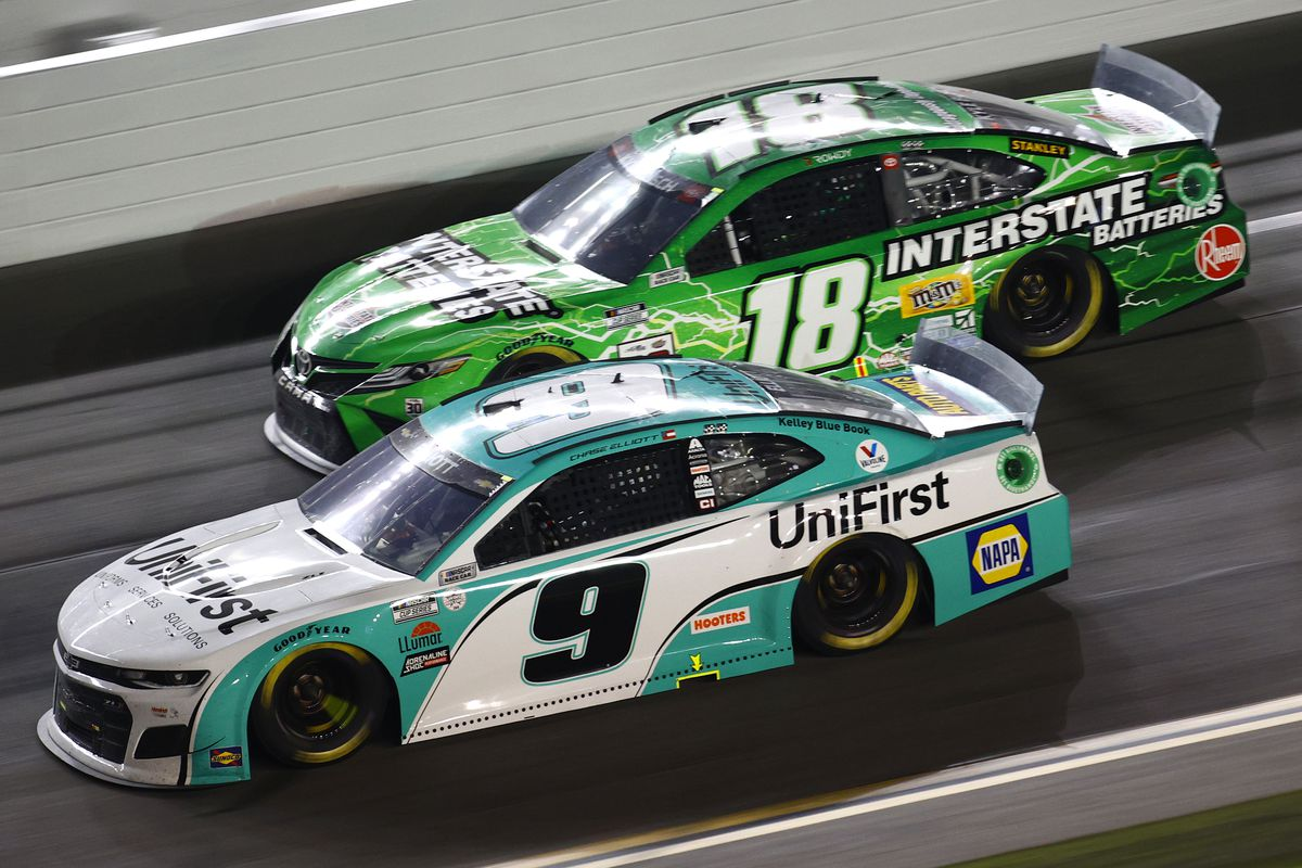 Chase Elliott, driver of the #9 UniFirst Chevrolet, and Kyle Busch, driver of the #18 Interstate Batteries Toyota, race during the NASCAR Cup Series Coke Zero Sugar 400 at Daytona International Speedway on August 28, 2021 in Daytona Beach, Florida.