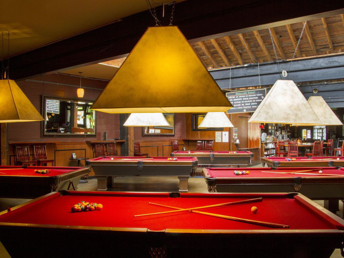 A view of the crimson-topped pool tables at Ballroom in Fremont.