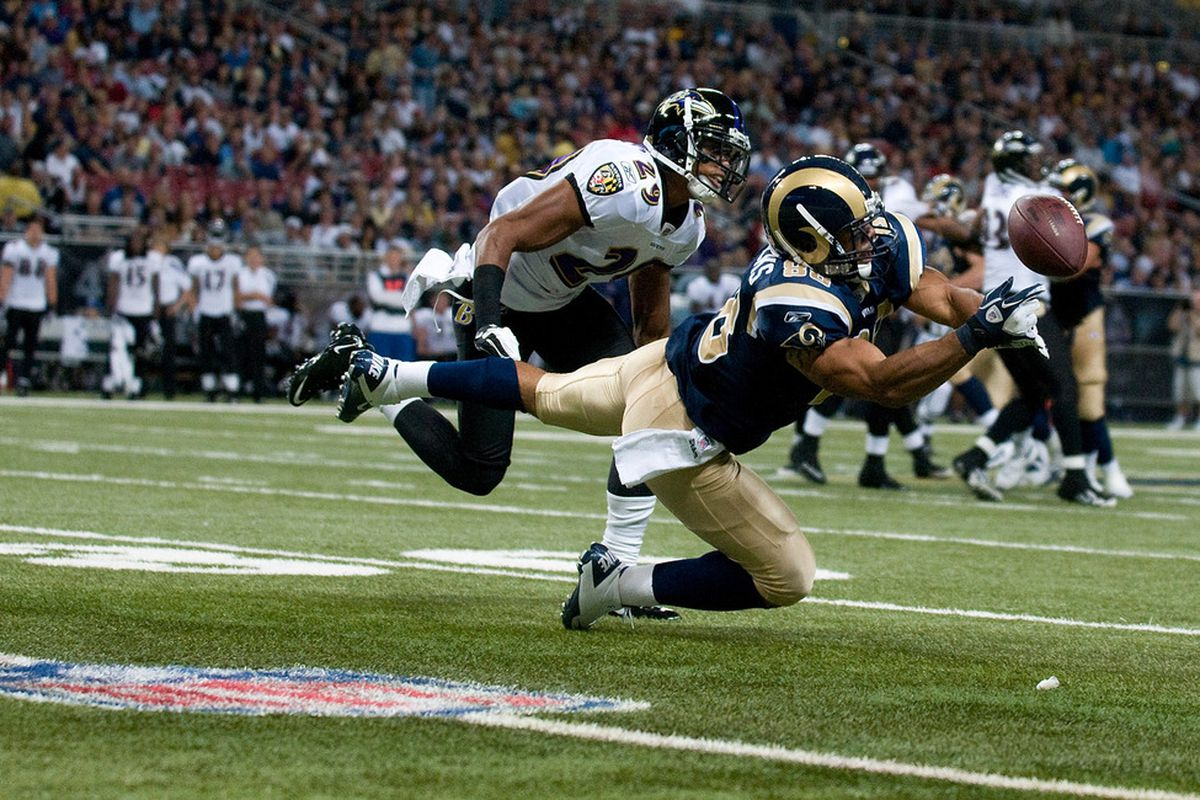 ST. LOUIS, MO - SEPTEMBER 25: Lance Kendricks #88 of the St. Louis Rams drops a pass as Cary Williams #29 of the Baltimore Ravens defends at the Edward Jones Dome on September 25, 2011 in St. Louis, Missouri. (Photo by Jeff Curry/Getty Images)