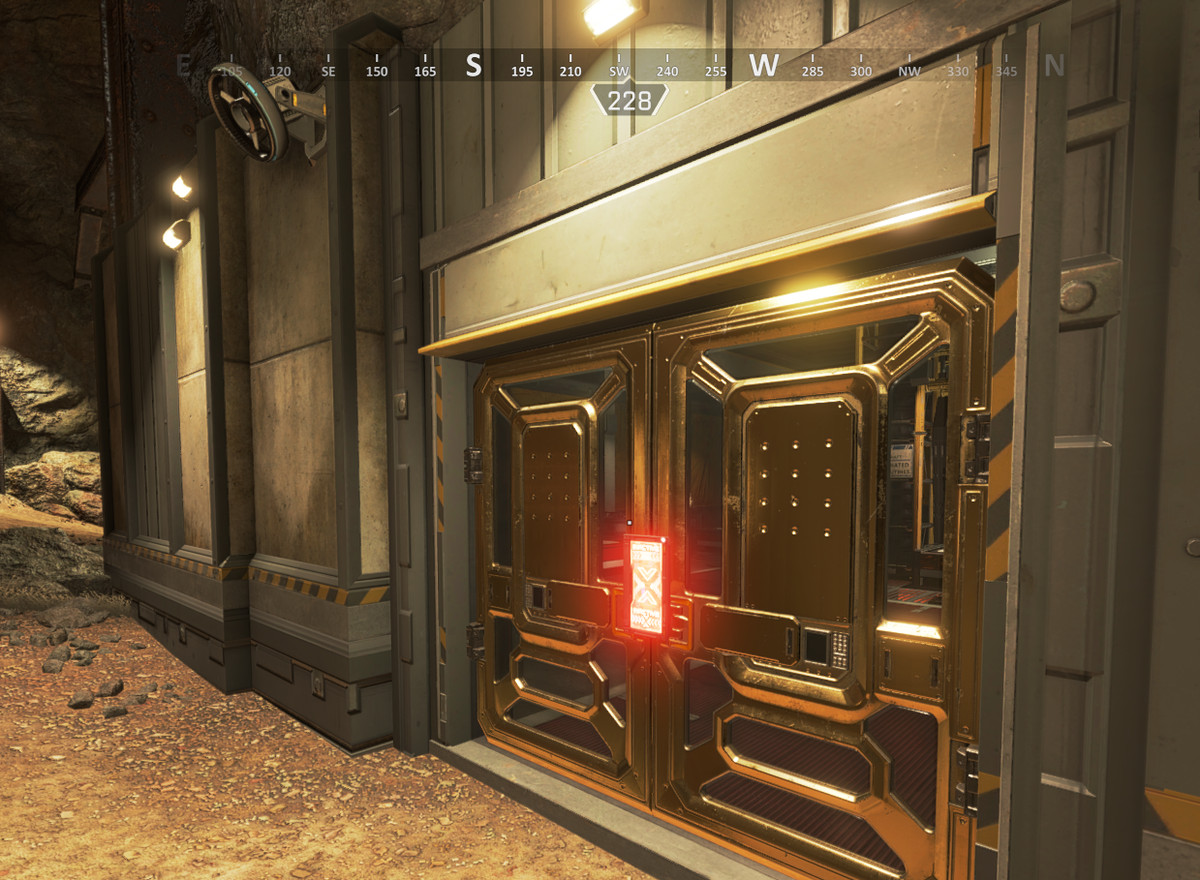A closed door in Apex Legends with a red hologram in front of it.