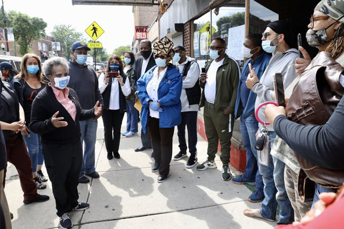 Mayor Lori Lightfoot visited commercial areas on the South and West sides on Monday to assess damage from a weekend of riots and looting.