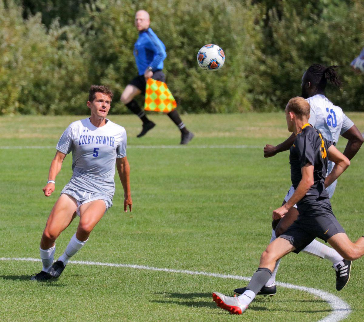 Couper Gunn playing soccer.