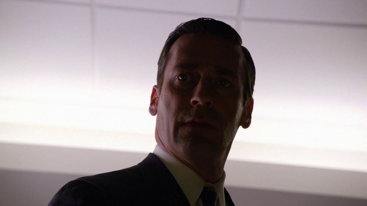 Don looks into an empty elevator shaft on Mad Men.