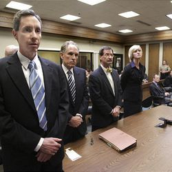 Warren Jeffs, left, and his defense attorneys react on Sept. 25, 2007, as the FLDS leader is convicted of being an accomplice to rape.