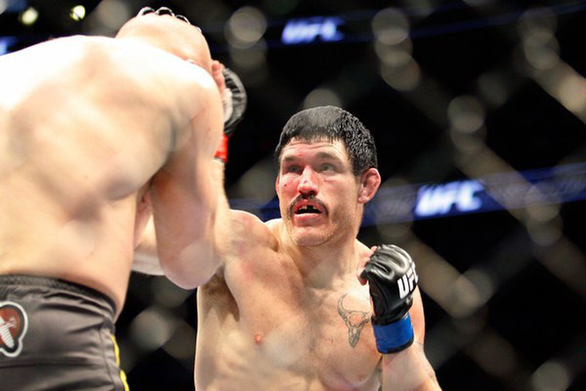 MONTREAL- MAY 8:  Tom Lawlor (R) hits Joe Doerksen in their middleweight bout at UFC 113 at Bell Centre on May 8, 2010 in Montreal, Quebec, Canada.  (Photo by Richard Wolowicz/Getty Images)
