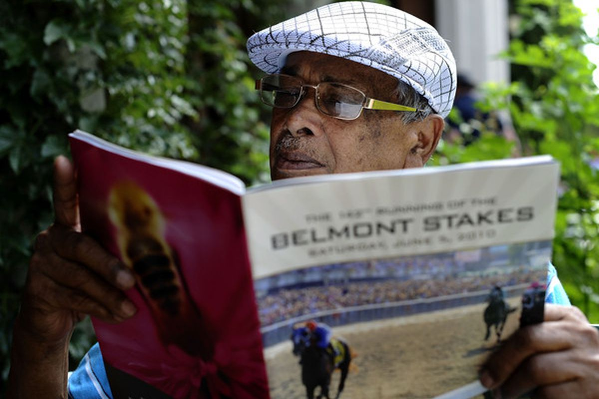 ELMONT, NY - JUNE 05:  Danny Singh reviews the racing program before racing gets underway at the 142nd Running of the Belmont Stakes at Belmont Park on June 5, 2010 in Elmont, New York.  (Photo by Jeff Zelevansky/Getty Images)