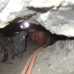 An unidentified rescue worker, works near John Jones in the Nutty Putty Cave, Wednesday, Nov. 25, 2009. Jones died after being trapped for over 24 hours.