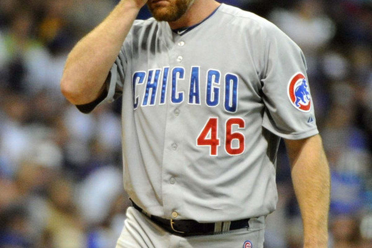 Milwaukee, WI, USA; Chicago Cubs pitcher Ryan Dempster reacts after giving up his first base hit to Milwaukee Brewers shortstop Cody Ransom (not pictured) at Miller Park. Credit: Benny Sieu-US PRESSWIRE