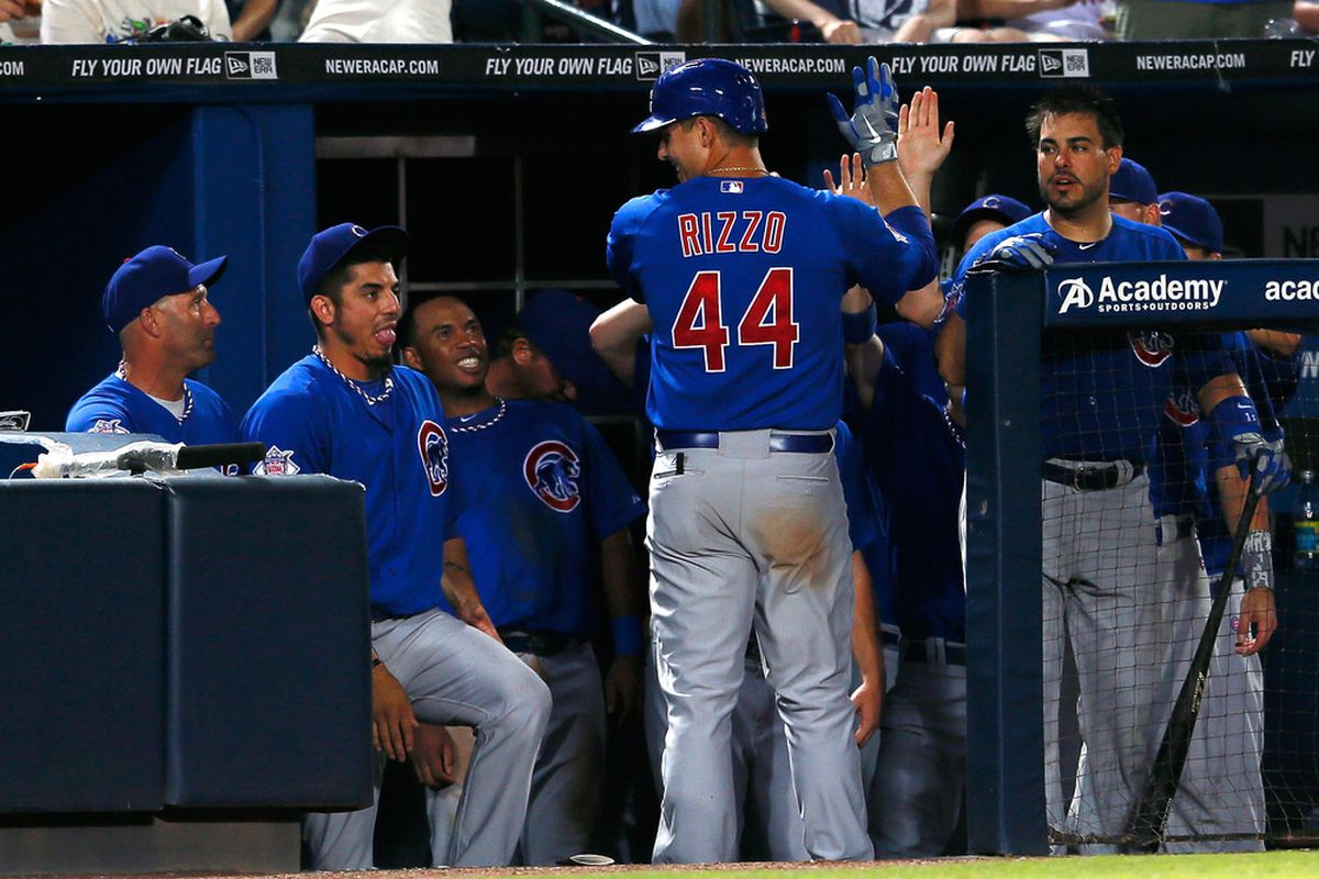 Anthony Rizzo of the Chicago Cubs celebrates with teammates after a solo homer against the Atlanta Braves at Turner Field in Atlanta, Georgia.  (Photo by Kevin C. Cox/Getty Images)
