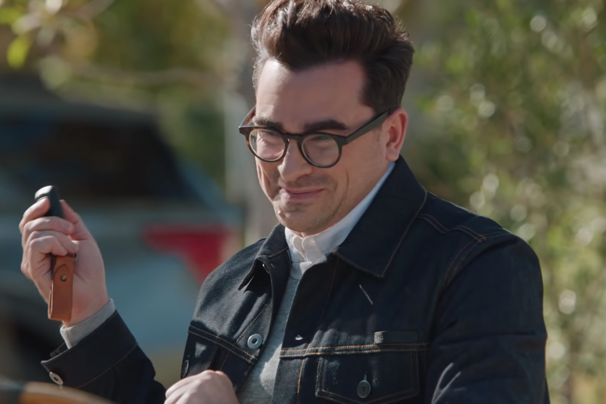 Out actor director Dan Levy holds a key fob in a new M&Ms commercial set to air during the Super Bowl.