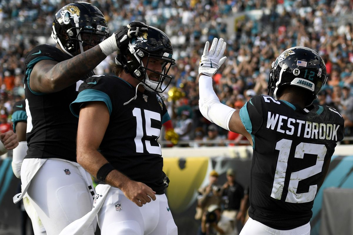 Jacksonville Jaguars wide receiver Dede Westbrook celebrates a touchdown with quarterback Gardner Minshew during the fourth quarter against the Tampa Bay Buccaneers at TIAA Bank Field.