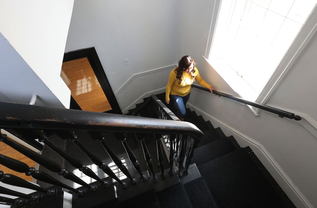 Vicky Chavez, who for three years has sought sanctuary with her young daughters at the First Unitarian Church of Salt Lake City, climbs the stairs to her room at the church on Wednesday, March 24, 2021. Chavez and three other women in similar situations in other states are suing U.S. immigration officials, alleging they are facing steep fines because they spoke out about their cases.