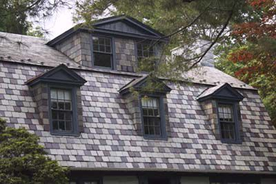 Four dormers lined up on a roof.