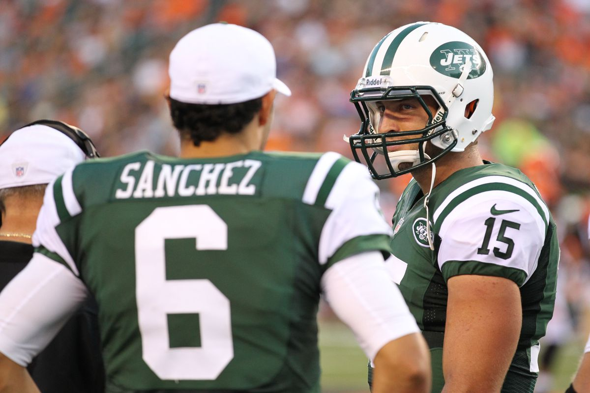 Aug 10, 2012; Cincinnati, OH, USA; New York Jets quarterback Tim Tebow (15) talks with quarterback Mark Sanchez (6) during a timeout in the second quarter against the Cincinnati Bengals at Paul Brown Stadium. Matthew Emmons-US PRESSWIRE