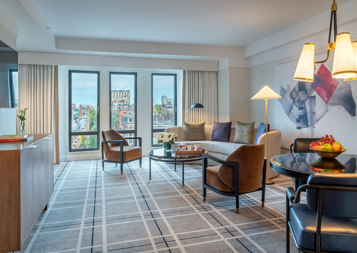 Rendering of a spacious hotel suite with furniture.