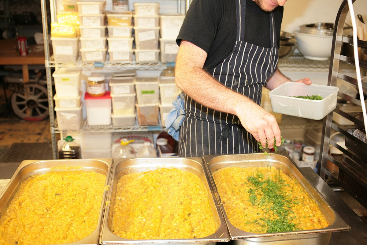 Nick Bramham, head chef of Quality Wines in Farringdon, preparing meals for NHS workers, DeliverAid
