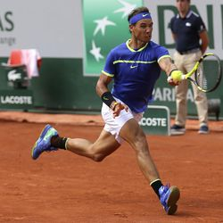 Spain's Rafael Nadal returns the ball to Switzerland's Stan Wawrinka during their final match of the French Open tennis tournament at the Roland Garros stadium, Sunday, June 11, 2017 in Paris.