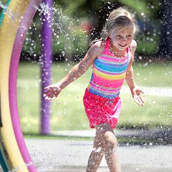 Heidi Datwyler plays in the splash pad at Liberty Park in Salt Lake City on Monday, June 19, 2017.