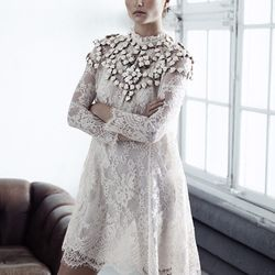 Lace A-line dress, $249; shoulder piece made of recycled plastic beads, $149