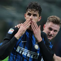 Andrea Ranocchia of FC Internazionale Milano celebrates his goal with his team-mate Milan Skriniar (R) during the serie A match between FC Internazionale and Benevento Calcio at Stadio Giuseppe Meazza on February 24, 2018 in Milan, Italy.