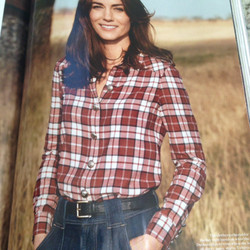 Here, she wears a plaid Burberry shirt and 7 for All Mankind palazzo pants.