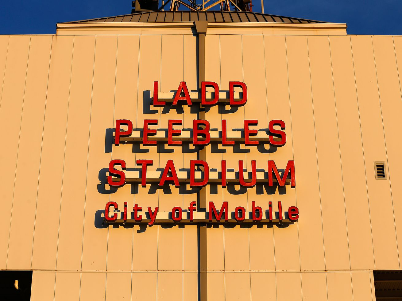 """""""Ladd Peebles Stadium, City of Mobile"""" is spelled out in red letters on the side of the arena."""
