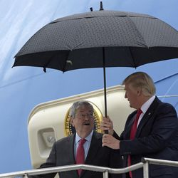President Donald Trump talks with former Iowa Governor Terry Branstad and Ambassador to China as they walk off of Air Force One at Eastern Iowa Airport, in Cedar Rapids, Iowa, Wednesday, June 21, 2017. Trump is visiting Iowa for the first time since the election. He will visit Kirkwood Community College which is recognized by the White House as a major center of agricultural innovation and speak at a rally.