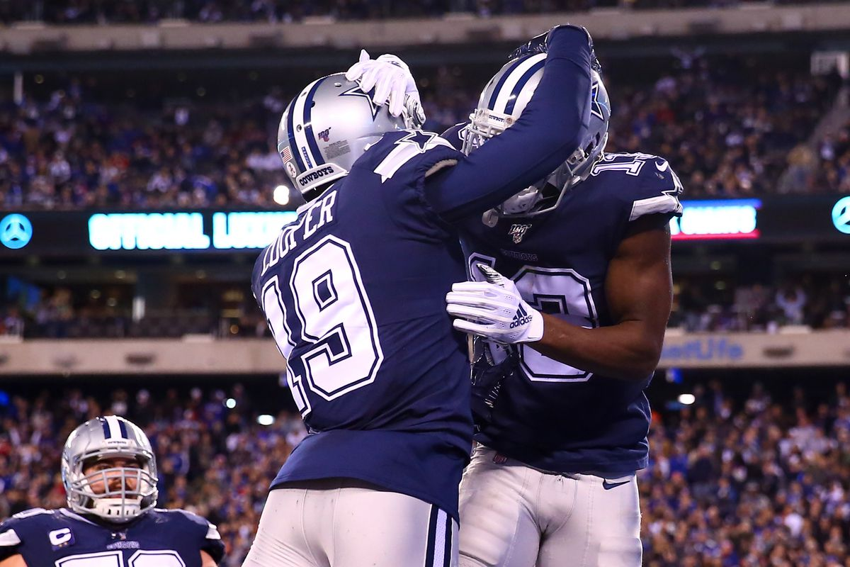 Dallas Cowboys wide receiver Michael Gallup celebrates with teammate Dallas Cowboys wide receiver Amari Cooper during the fourth quarter of the National Football League game between the New York Giants and the Dallas Cowboys on November 4, 2019 at MetLife Stadium in East Rutherford, NJ.