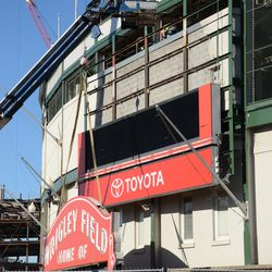 1:33 p.m. The bare brick is now visible, where the upper portion of the marquee was located -
