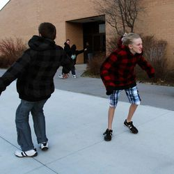 Farmington Junior High students fight the wind as they walk outside before school, Thursday, Dec. 1, 2011.