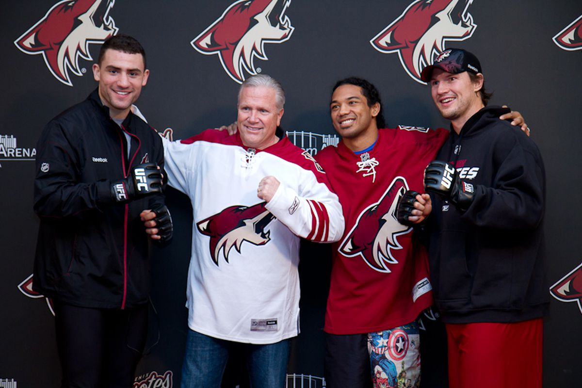 Phoenix Coyotes Paul Bissonnette and Shane Doan pose with WEC founder Reed Harris and lightweight champion Benson Henderson. Photo by Ryan Malone.