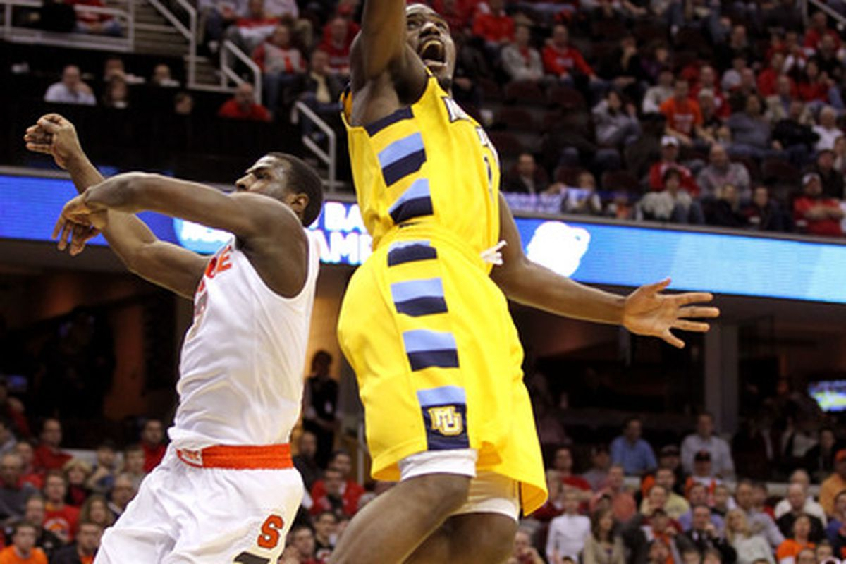 Darius Johnson-Odom of Marquette drives to the basket against Dion Waiters of Syracuse during the NCAA tournament.