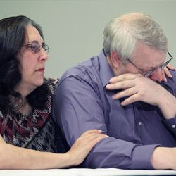 Chuck Cox, right, the father of Susan Powell, who was reported missing Dec. 7, 2009, in Utah, is comforted  his wife Judy, as he and other family members talk to reporters, Thursday, Dec. 17, 2009, in Puyallup, Wash. Powell's family said Thursday they are saddened but not surprised that her husband Josh Powell has been named a person of interest in the investigation.