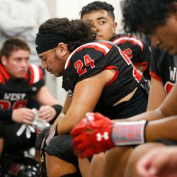 West's Bronsyn Saena (24) closes his eyes as he prays before a high school football game against Roy High on Friday, Sept. 10, 2021, at West High School in Salt Lake City.