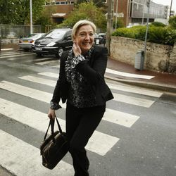 French far right National Front party leader Marine Le Pen makes her way to a restaurant in Nanterre, northwest of Paris, Monday, April 23, 2012. Le Pen placed third in Sunday's first round of voting in the presidential elections, with 17.9 percent, the best showing ever by the National Front party founded by her father Jean-Marie Le Pen.