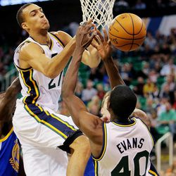 Utah's Rudy Gobert and teammate Jeremy Evans try to control the ball as the Utah Jazz and the Golden State Warriors play Tuesday, Oct. 8, 2013 in preseason action at Energy Solutions arena in Salt Lake City.