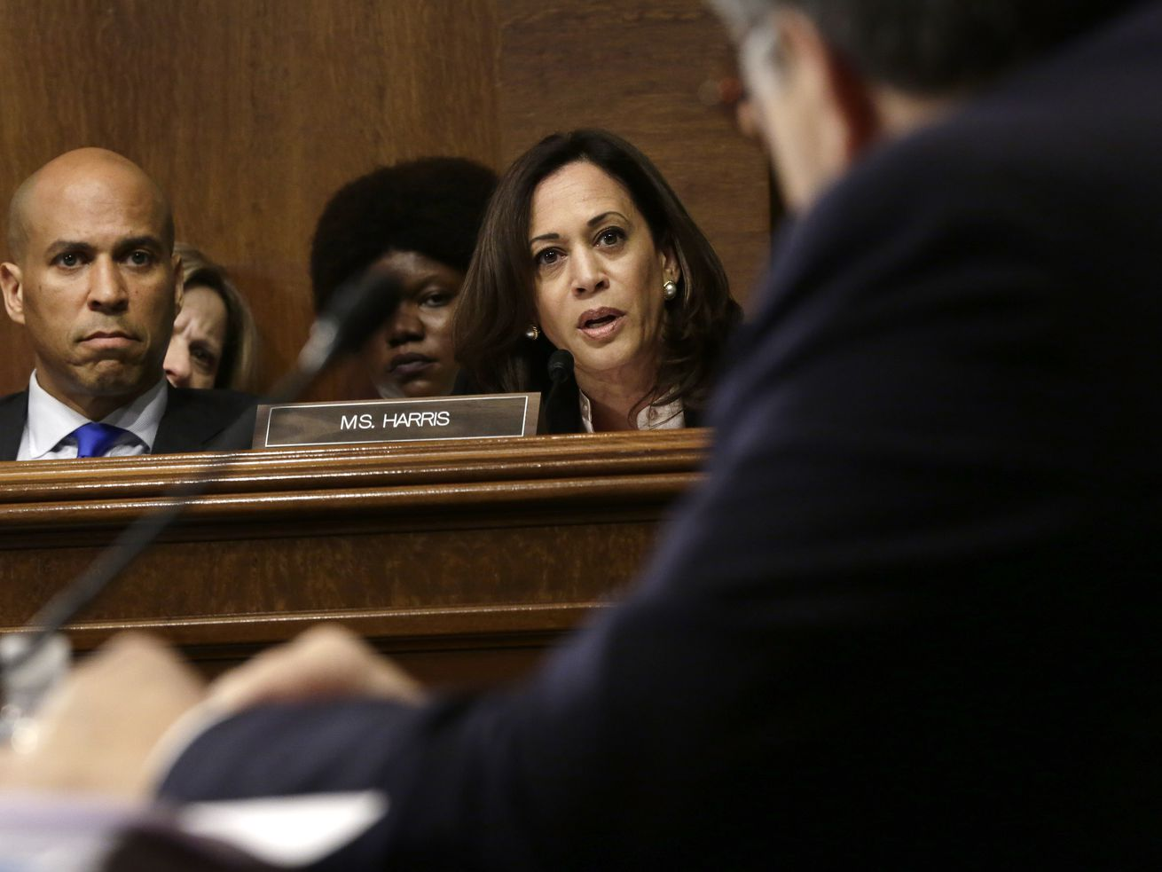 Sen. Kamala Harris (D-CA) speaks and Sen. Cory Booker (D-NJ) listens as Attorney General William Barr testifies before the Senate Judiciary Committee May 1, 2019, in Washington, DC.