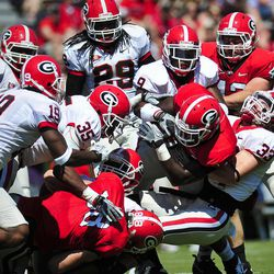The Black Team's defense tackles Ken Malcome during the first half of G-Day, the University of Georgia NCAA college spring football game in Athens, Ga., Saturday, April 14, 2012.