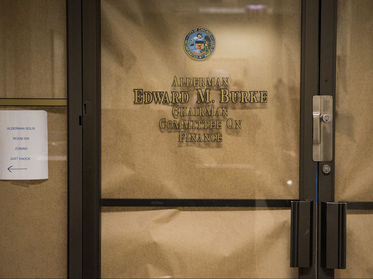 Brown paper covers the windows of Ald. Edward Burke's office at Chicago City Hall, on Nov. 29. | Ashlee Rezin/Sun-Times file photo