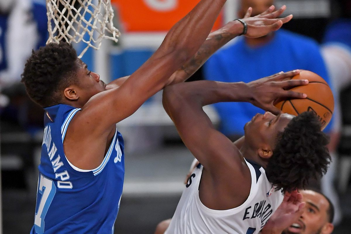 Los Angeles Lakers forward Kostas Antetokounmpo (37) blocks a shot by Minnesota Timberwolves guard Anthony Edwards (1) in the second half of the game at Staples Center.