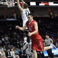 Utah Valley's Conner Toolson (11) is fouled by Seattle's Zackary Moore during the second half of an NCAA college basketball game in the first round of the Western Athletic Conference tournament Thursday, March 9, 2017, in Las Vegas.