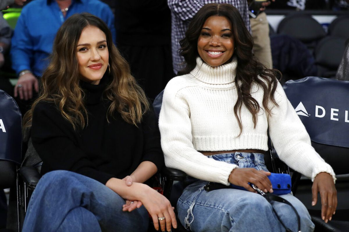 Jessica Alba, left, and Gabrielle Union at an NBA basketball game between the Los Angeles Lakers and the Miami Heat in Los Angeles