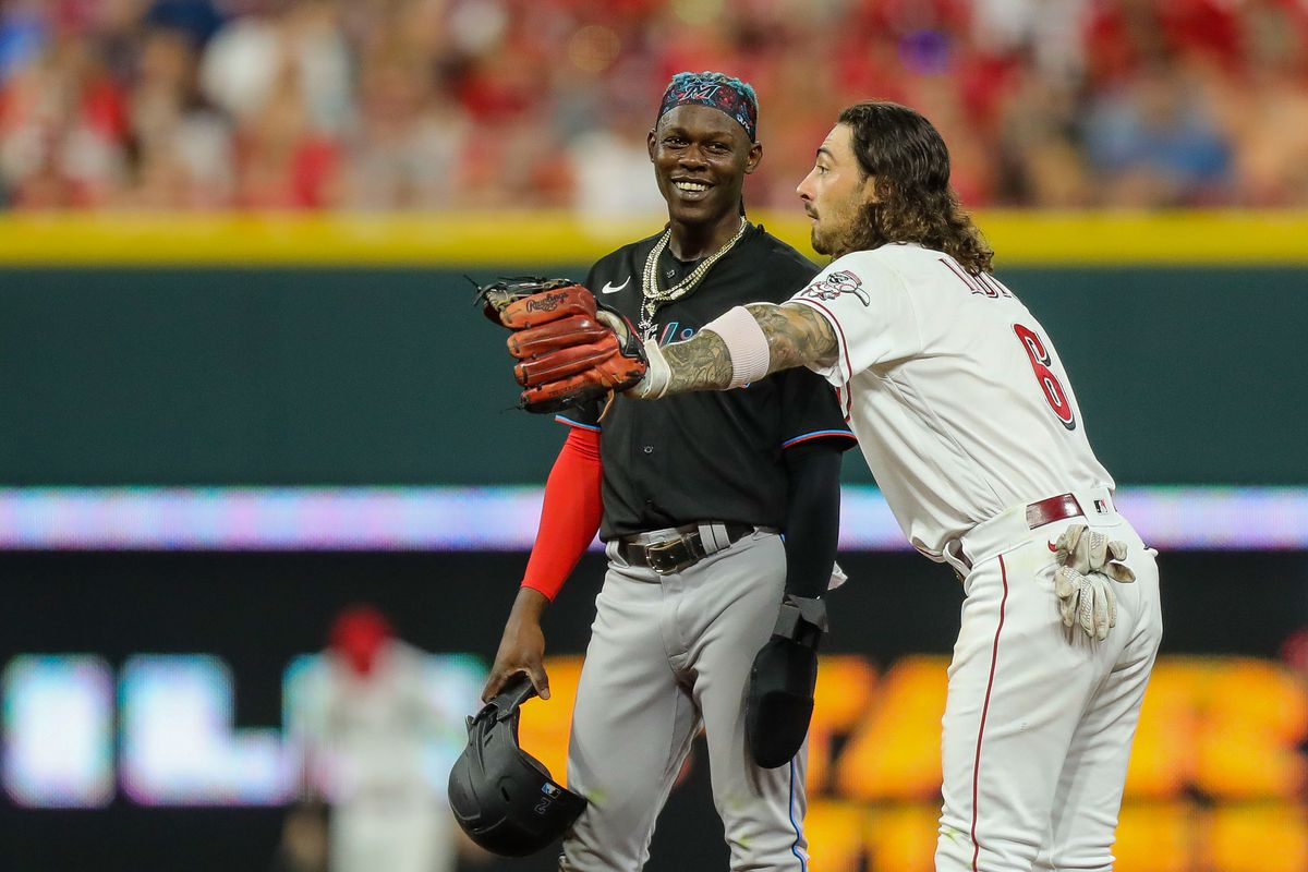 Miami Marlins second baseman Jazz Chisholm Jr. (2) talks with Cincinnati Reds second baseman Jonathan India (6) in the eighth inning at Great American Ball Park