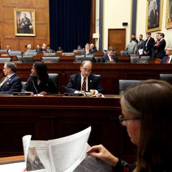 Rep. French Hill, R-Ark., Rep. Mia Love, R-Utah, and Rep. Bruce Poliquin, R-Maine, attend a Financial Services Committee meeting at the U.S. Capitol in Washington, D.C., on Tuesday, Dec. 8, 2015.
