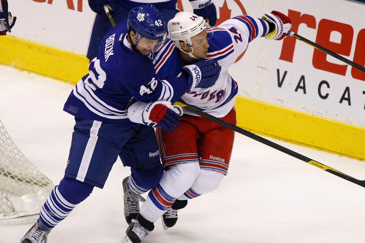 March 24, 2012; Toronto, ON, CANADA; Toronto Maple Leafs center Tyler Bozak (42) defends New York Rangers forward Ryan Callahan (24) during the first period at the Air Canada Centre. Mandatory Credit: John E. Sokolowski-US PRESSWIRE