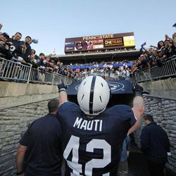 Penn State linebacker Michael Mauti (42) walks off the field to cheering fans after a 24-13 win over Temple in an NCAA college football game in State College, Pa., Saturday, Sept. 22, 2012.