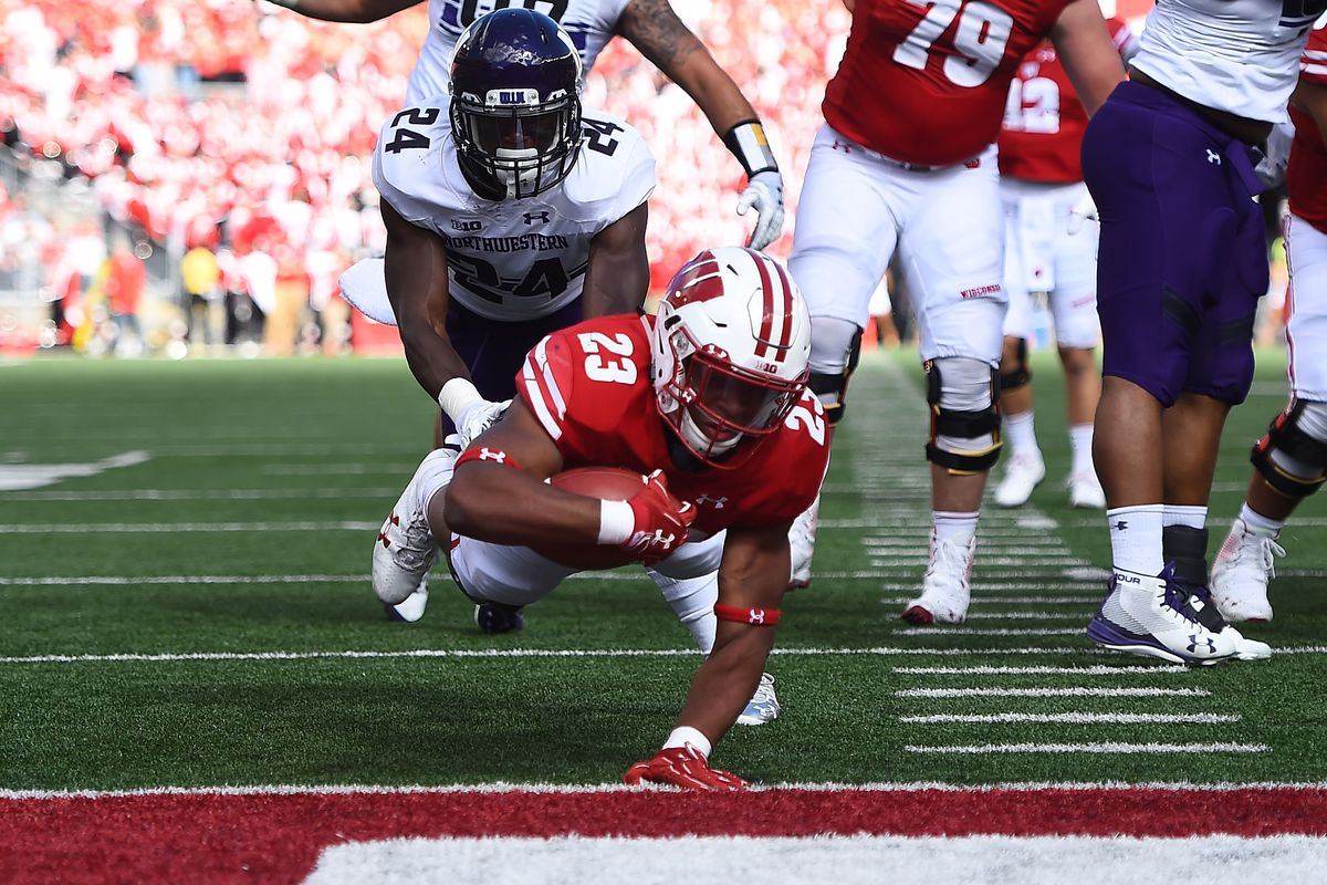 Taylor's rushing leads No. 9 Badgers past Cornhuskers