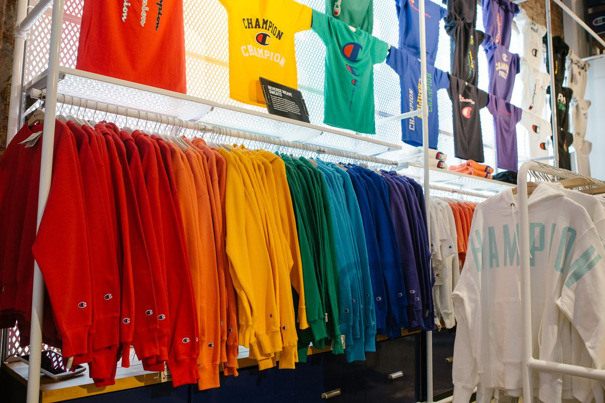 Sweatshirts are displayed for sale at the Champion store in rainbow order.