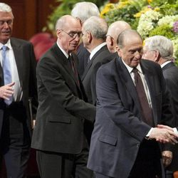 The First Presidency walks off the stand shaking hands with the Twelve after the afternoon session Saturday, April 6, 2013 of the 183th Annual General Conference of The Church of Jesus Christ of Latter-day Saints in the Conference Center.