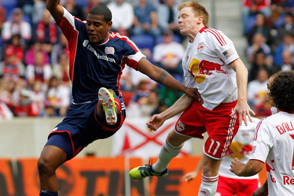 HARRISON, NJ - APRIL 28: Jose Moreno #9 of the New England Revolution and Dax McCarty #11 of the New York Red Bulls go up for a header during the game at Red Bull Arena on April 28, 2012 in Harrison, New Jersey. (Photo by Andy Marlin/Getty Images)